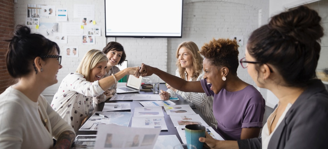 Women celebrating in a meeting