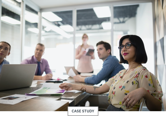 """Employees sitting at a conference table with a """"case study"""" subhead"""