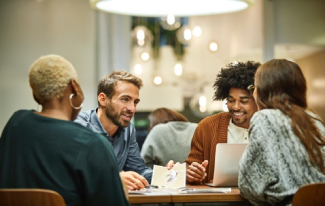 People talking in a group at a table