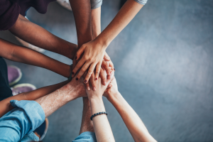 One of the 6 keys to improving customer service is building an engaged support team. Sometimes that involves huddling up and saying some motivating words before putting in a day's worth of work.